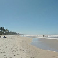 Photo taken at Praia da Costa by Mariana M. on 7/18/2016