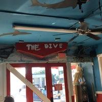 Photo taken at The Dive Food & Spirits by Ben C. on 7/8/2017