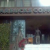 Photo taken at Starbucks by Itzel L. on 12/18/2012