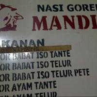 Photo taken at Nasi Goreng Babat Iso Mandiri by Wea on 12/16/2012