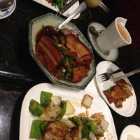 Photo taken at Green Island Restaurant by R C. on 12/26/2014