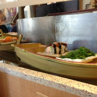 Photo taken at Floating Sushi Boat by Kevin W. on 7/6/2013