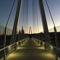 Photo taken at Mary Avenue Bicycle Footbridge by Calvin T. on 12/27/2015