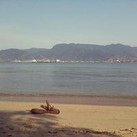 Photo taken at Praia do Perequê by Adriano A. on 9/19/2012
