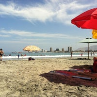 Photo taken at Playa Cavancha by Mauricio V. on 1/28/2013