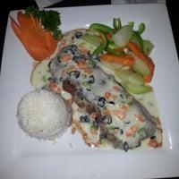 Photo taken at Grand Cafe by Atanasio R. on 4/17/2014