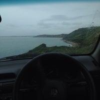 Photo taken at Osmington Bay Beach by James M. on 6/16/2013