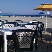 Photo taken at Oasi Cafè - Poetto Beach by Полина 🍒 З. on 9/21/2012