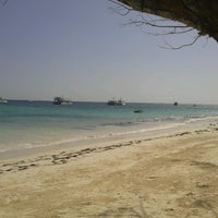 Photo taken at Playa Los Corales by Anabelle H. on 9/23/2012