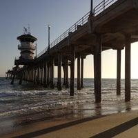 Photo taken at Huntington Beach Pier by Migzy V. on 4/28/2013