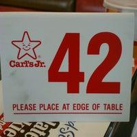 Photo taken at Carl's Jr. by Eric O. on 3/16/2013