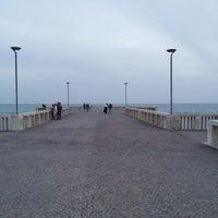 Photo taken at Pontile di Ostia by Fabio B. on 5/3/2013