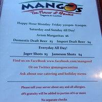 Photo taken at Mango's Taqueria and Cantina by Oksana B. on 5/1/2013