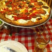 Photo taken at Grimaldi's Pizzeria by Cora on 10/30/2012