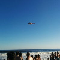 Photo taken at Bikini Beach by Agustin N. on 1/6/2014