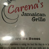 Photo taken at Carena's Jamaican Grille by Jamie on 6/9/2016