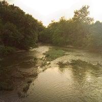 Photo taken at White River Monon Bridge by Bryan J. on 7/12/2013