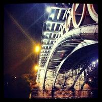 Photo taken at Isabel II Bridge 'Triana Bridge' by Amayita R. on 10/5/2012