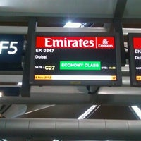 Photo taken at Emirates Checkin Counter by azmi k. on 11/18/2012