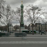 Photo taken at Place de la Bastille by Alexander V. on 4/10/2013