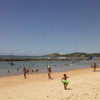 Photo taken at Enseada dos Corais by Emiliano I. on 4/7/2013