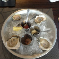 Photo taken at Rappahanock Oyster Bar by Adrienne D. on 3/27/2013