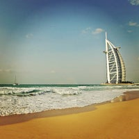 Photo taken at Madinat Jumeirah Private Beach by Alexander S. on 12/24/2012