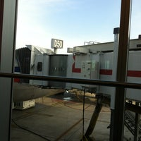 Photo taken at Gate D60 by Patricia S. on 3/12/2013