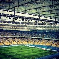 Photo taken at Olimpiyskiy Stadium by Angelina L. on 10/6/2013