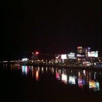 Photo taken at Han River Bridge by Vinh T. on 9/16/2012