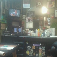Photo taken at Autograf Tattoo by Katie B. on 10/4/2012