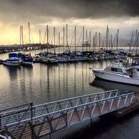 Photo taken at Rainbow Bay Marina by Eiríkr J. W. on 1/3/2013