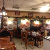 Photo taken at Ganda Restaurant by JoJo O. on 11/25/2012