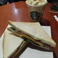 Photo taken at Starbucks by Lorraine Y. on 3/5/2014