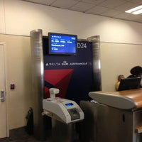 Photo taken at Gate D24 by Chris A. on 12/13/2012