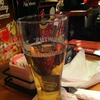 Photo taken at Applebee's Neighborhood Grill & Bar by David S. on 12/31/2012