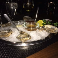 Photo taken at Eddie V's Prime Seafood by Tim C. on 2/9/2014
