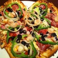 Photo taken at Boston Pizza by Julia L. on 2/15/2013