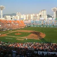 Photo taken at Sajik Baseball Stadium by Yeonou T. on 5/11/2013