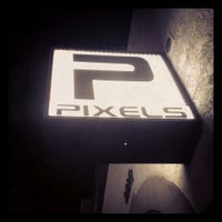 Photo taken at Pixels Bar by Christopher N. on 7/9/2013