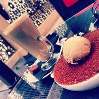 Photo taken at Emporio Armani Café- The Pearl Qatar by HBA on 1/9/2013
