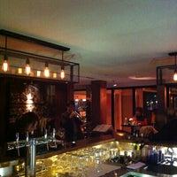 Photo taken at Le Café by Carolyn P. on 1/18/2013