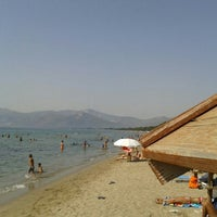 Photo taken at Παραλία Δελφίνι by Nikos D. on 9/6/2015