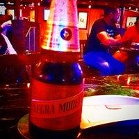 Photo taken at Q Restaurant & Sports Bar by Shawn on 7/28/2014