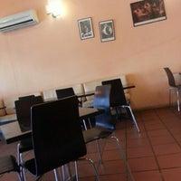 Photo taken at Café Caffè by Ridzuan A. on 11/30/2012