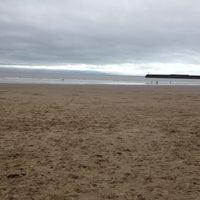 Photo taken at Porthcawl Beach by Tom R. on 4/5/2014