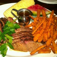 Photo taken at Lucille's Smokehouse Bar-B-Que by OkeeCho B. on 2/4/2013