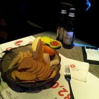 Photo taken at Icon Lounge by Mina P. on 2/13/2013