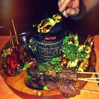 Photo taken at Yuca Bar & Restaurant by Lulu X. on 10/5/2013