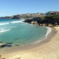 Photo taken at Tamarama Beach by Flavinha Y. on 9/4/2013